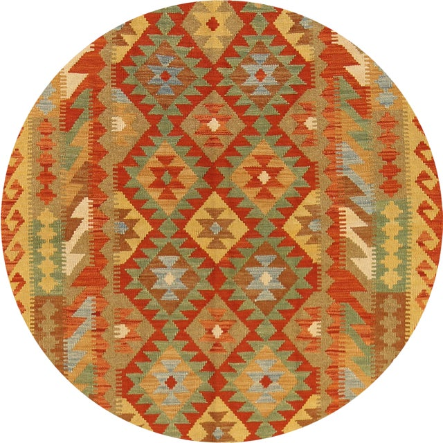 A hand-woven Kilim rug with a geometric motif. This piece has great detailing and a beautiful design. It would be the...
