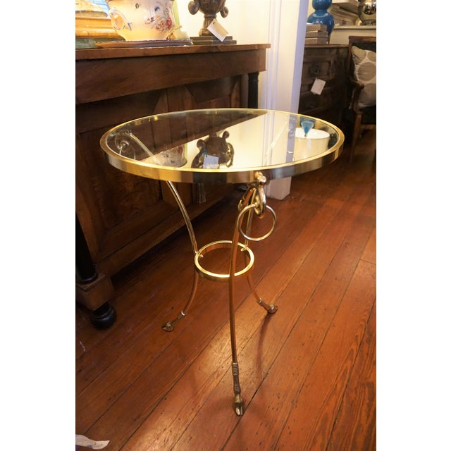 Pair of mid century girondoles tables with brass and glass top.