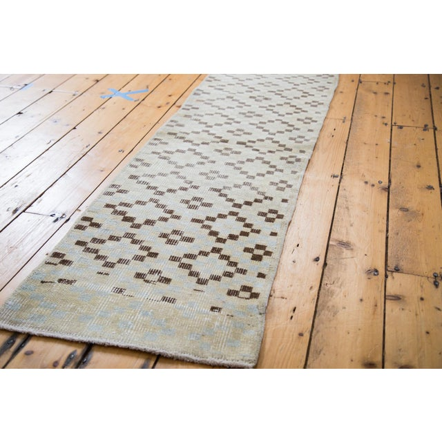 Vintage distressed diamond and checker Turkish rug runner with shades of ivory, silver, beige, charcoal and platinum....