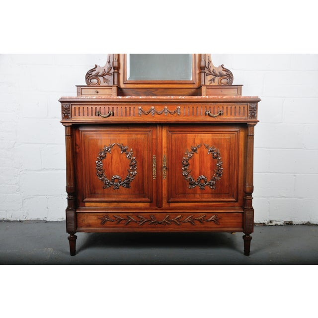 - 1900's French vanity dresser with red Italian marble top. The dresser features one big and spacious drawer on top with...