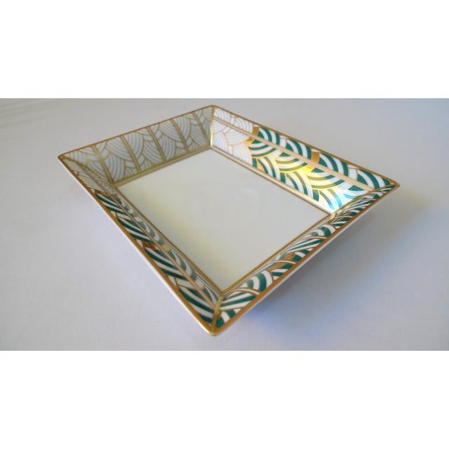 This is a beautiful white, green and multicolor porcelain tray with gilt accents, underside brand stamped, designed for...