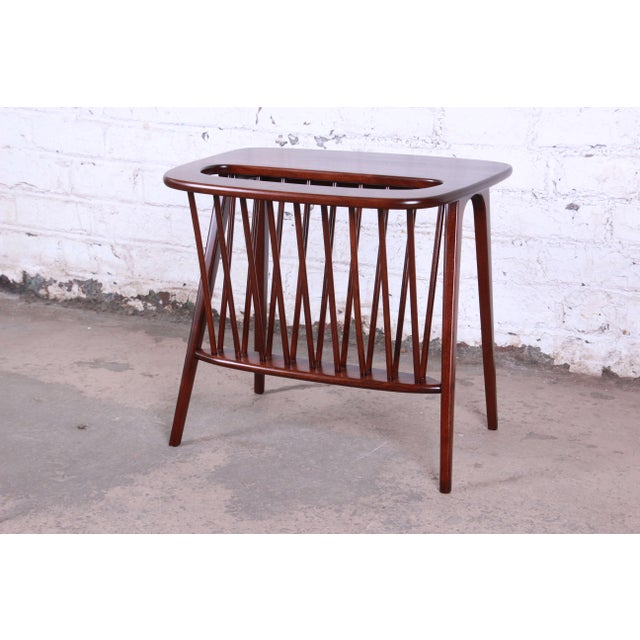 Offering a very sleek solid walnut magazine rack or side table by Arthur Umanoff. The rack has been newly refinished and...