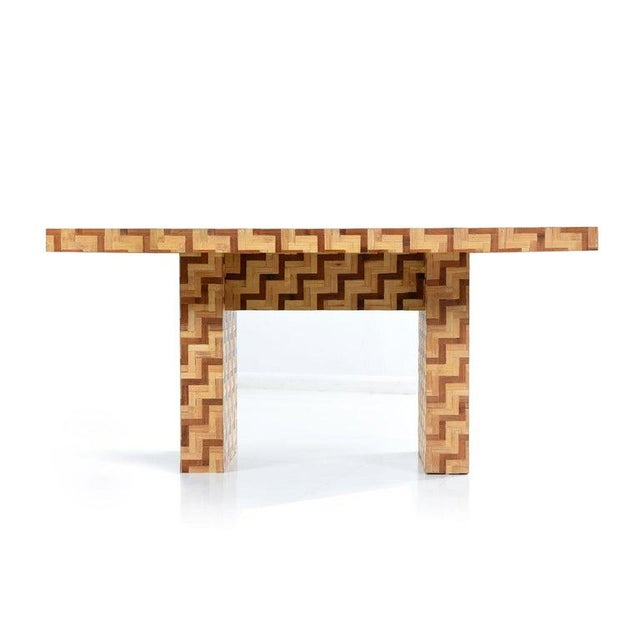 The multi-tone chevron parquet pattern of this rattan dining table is absolutely stunning. Also very practical as a desk....