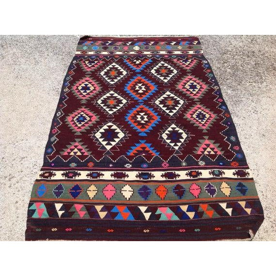 This beautiful vintage handwoven kilim is in fabulous shape. It is approximately 50 years old, handmade of very fine...
