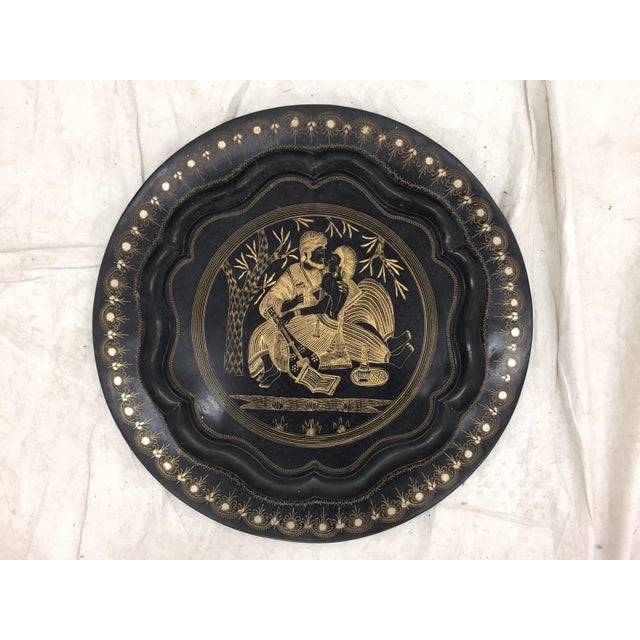 Charming Black Metal Charger Platter with beautiful Etched Scene depicting an adoring man and woman (is it love? Looks...