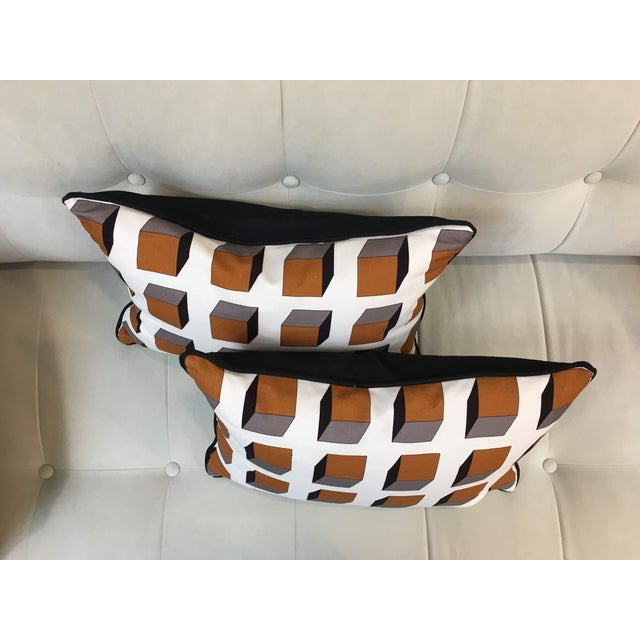 Pair of op art, geometric printed lumbar pillows in 100% cotton Gaston Y Daniela Lolo Ocre fabric with Piping and Backing...