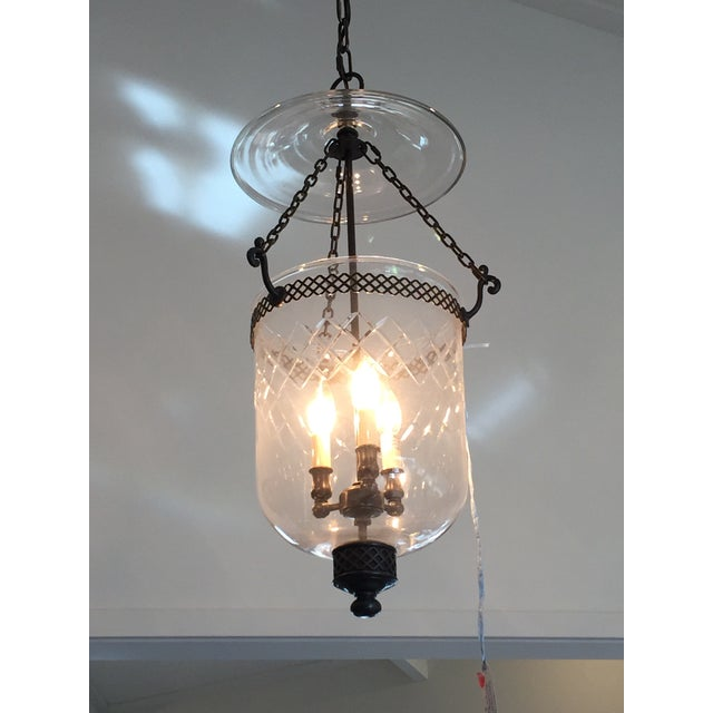 Newer lantern with bronze finish. The bell top is heavy, thick glass. Nice lattice cuts that mimic the lattice strapping....