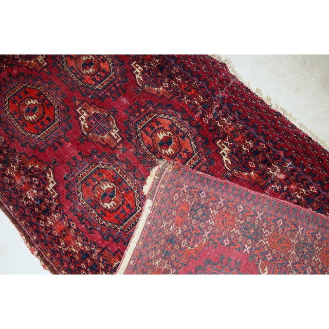 Handmade antique collectible Turkmen Saryk rug in scarlet shade. The rug is from the end of 19th century in original...