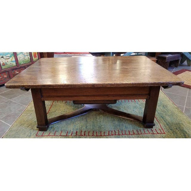 "Rustic French oak coffee table. Beautiful patina with a center-pull drawer and ""X"" structured base. Solid with additional..."
