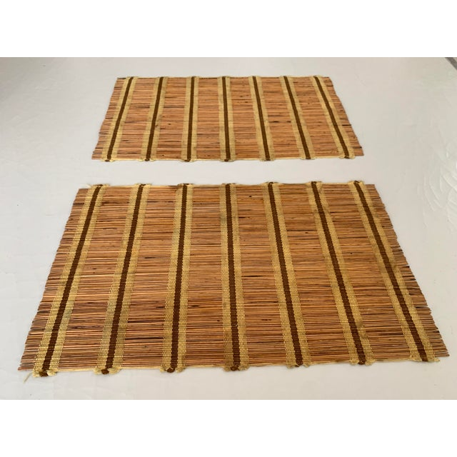 A set of 9 mid-century woven wood placemats in the style of Maria Kipp. Vintage condition with minimal staining. They roll...