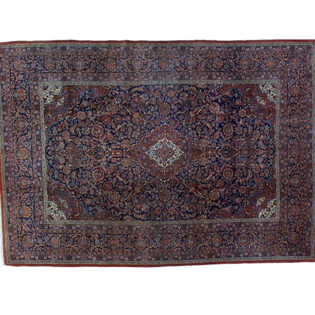 This master piece is an exceptionally fine Kork wool pile hand woven antique Persian Kashan carpet in excellent condition.