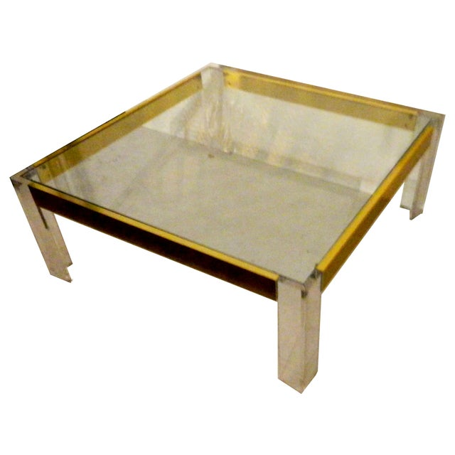 Embrace Italian elegance with this vintage, square Lucite and brass cocktail table from the 1970s.