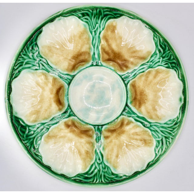 A superb Art Deco style French Salins oyster plate. Brilliant colors, unique scalloped shell geometric design with twisted...