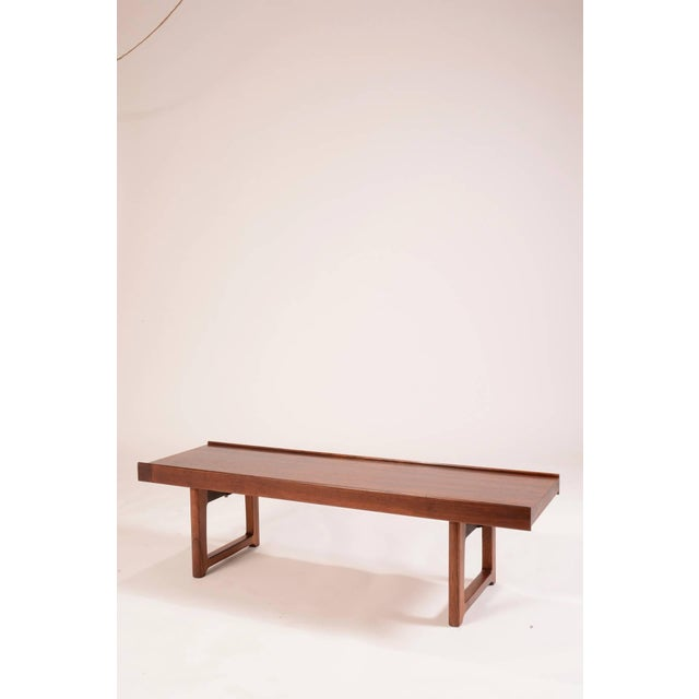 Rosewood bench designed by Torbjo¨rn Afdal for Bruksbo Møbler, Norway. This piece has been professionally restored to its...