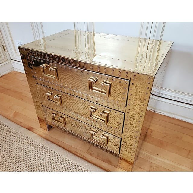 Sarreid three drawer vintage brass trunk or chest with rivets from the 70s. This chest is in excellent condition-...