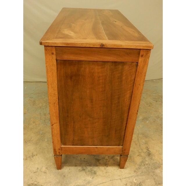 Carefully restored early 19th century walnut three drawer commode. Very nice warm patina.