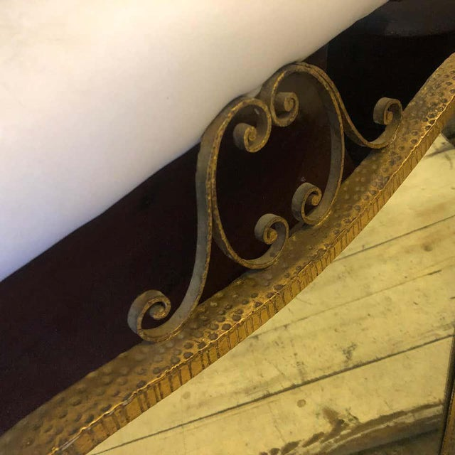 A gilded iron wall mirror made in Italy in the 1950s. Designed by Pier Luigi Colli, it's in very good conditions.