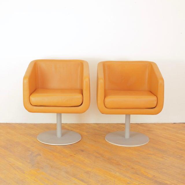 Great pair of cognac leather cube swivel chairs by Loewenstein. Kinda space age, kinda mid century.