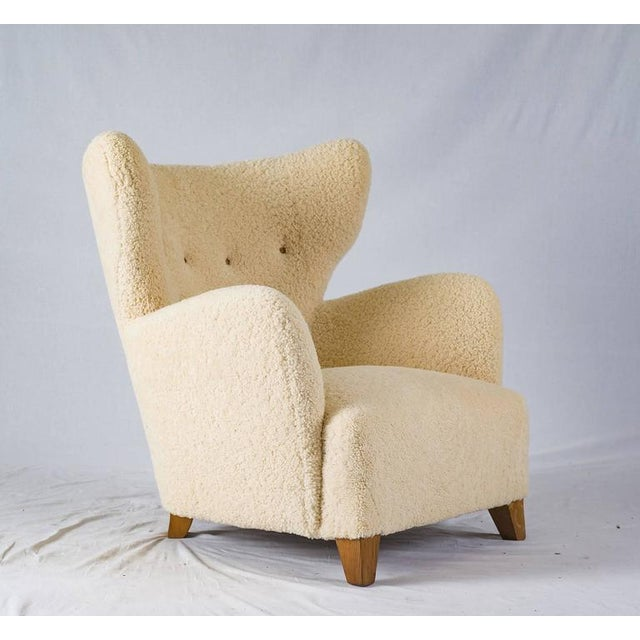 Scandinavian sheepskin lounge chair. NOTE: WE SOLD ONE OF THEM, AND ONLY HAVE ONE LEFT.