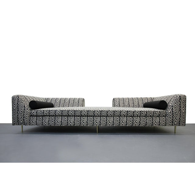 Absolutely stunning customized open back sofa with striking fabric and solid brass legs. This piece commands attention, so...