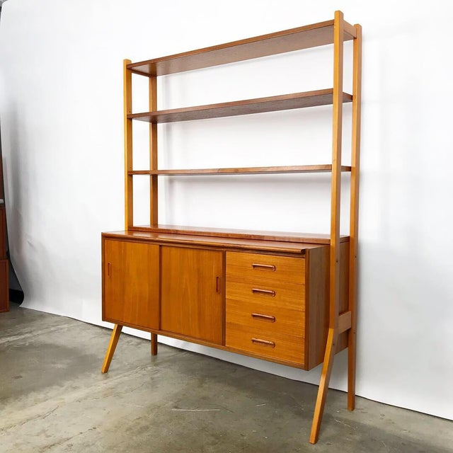 Newly refinished Swedish modern teak secretary cabinet. This piece has some great features including a retractable...