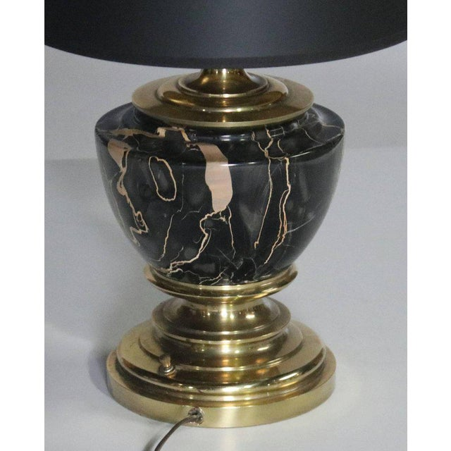 """Midcentury marble and brass table lamp by Stiffel, labelled. Complete with a custom black drum shade (11"""" x 9"""") with gold..."""