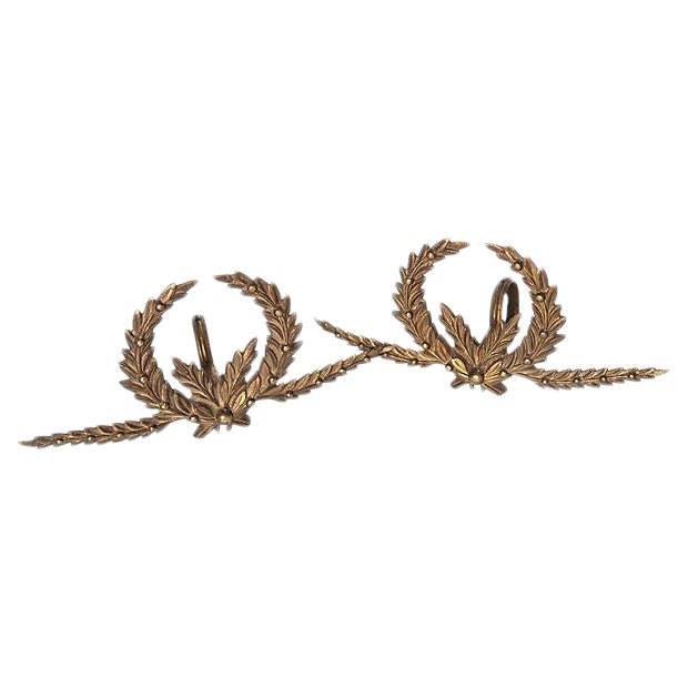 A Pair of Antique French Brass Drapery Rod Holders With Garland Design For Sale