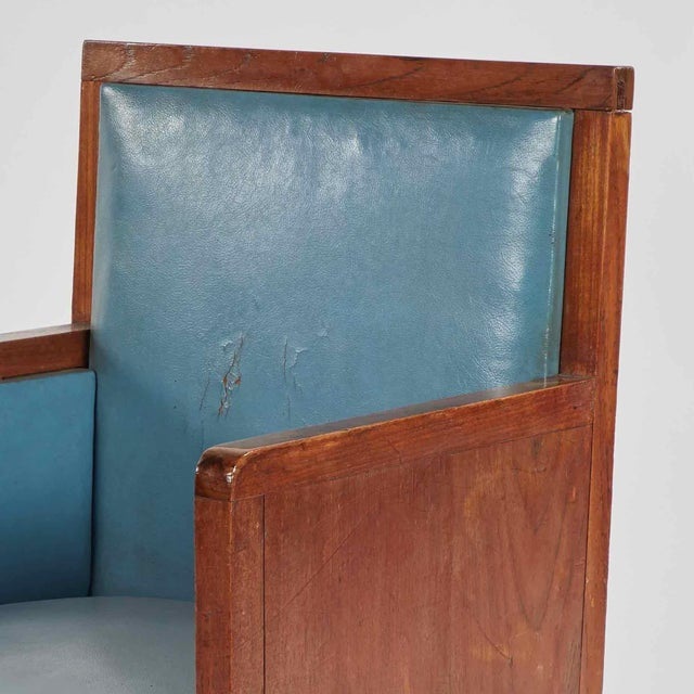 Art deco wooden armchair upholstered in blue leather from France.