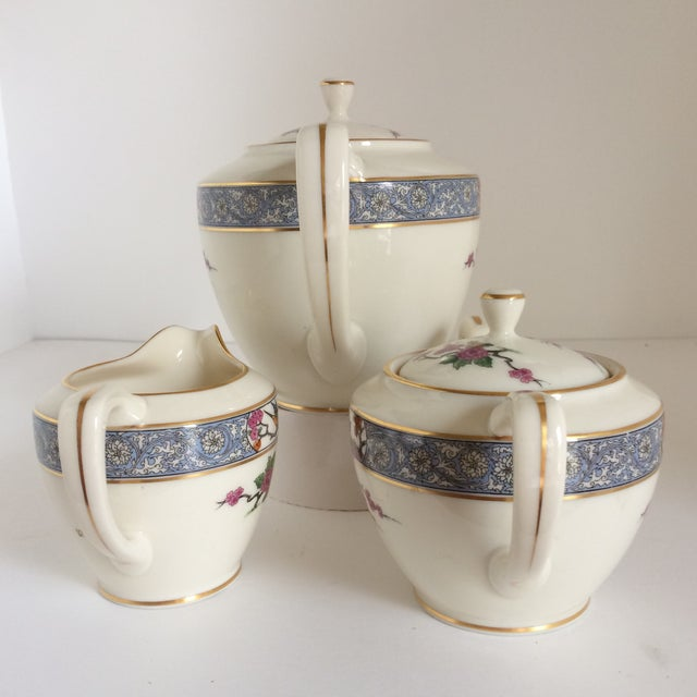 "Vintage ""Ming"" pattern teapot, sugar bowl and creamer made by Lenox. Wonderful set. Has a traditional Asian pattern in..."