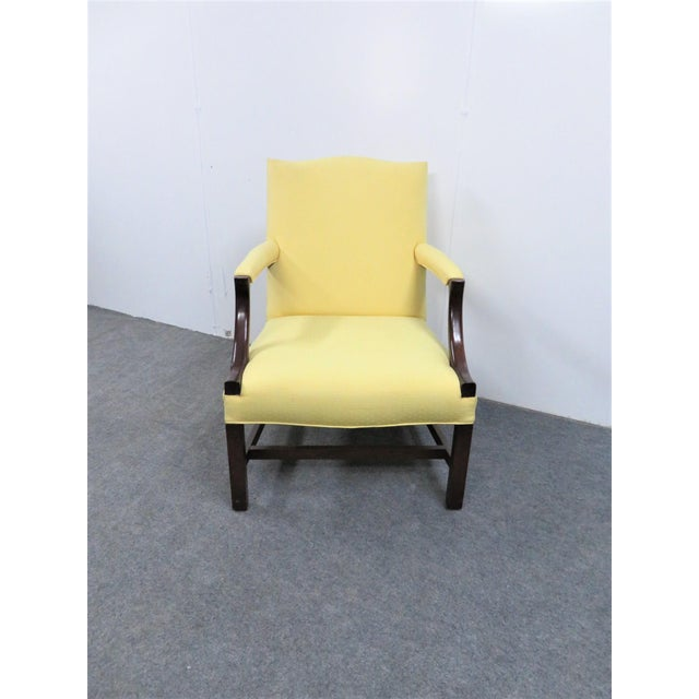 Custom made 1940's Chippendale library chair. Features mahogany frame and marlboro style legs.