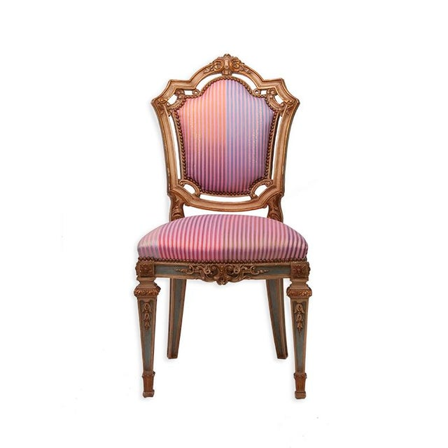 Offered is pair of Louis XVI style side chairs. Each of these elegant chairs features a gold frame with Syrian Damascus...