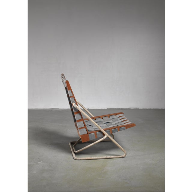 A prototype chair from 1960, by Austrian architect Walter E. Gindele (1925 - 2009). The chair has a cherry wood and ash...