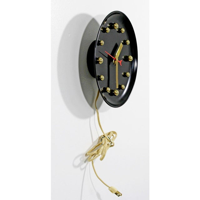 For your consideration is a stunning, black faced wall clock, with brass balls and hands George Nelson style, circa the...