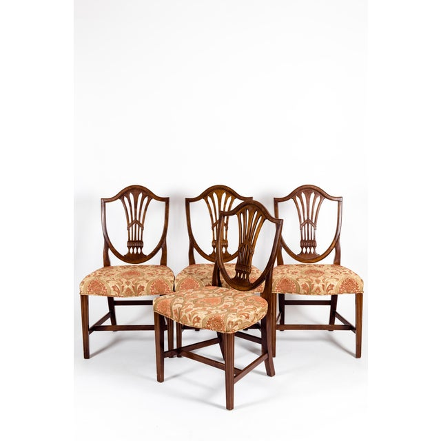 Solid mahogany wood shield back set of four dining chairs. Each chair is in excellent vintage sturdy condition. Minor wear...