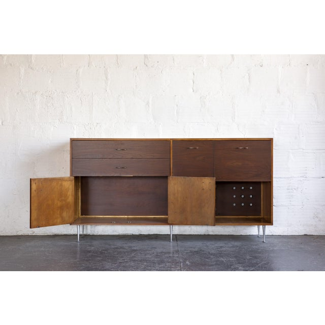 One of America's iconic designers, George Nelson designed many pieces for Herman Miller. This extravagant credenza...