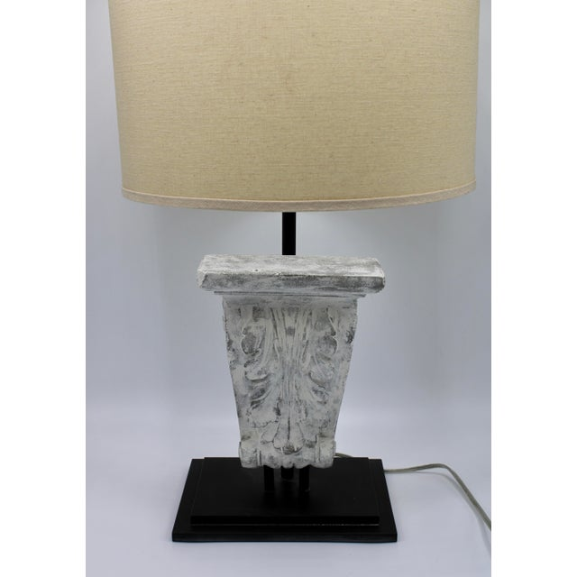 This unique lamp embodies the ornate symmetry of a classical corbel, mounted on an iron base. Custom design, Victorian...