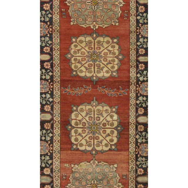 This beautiful rug is hand made, 100% wool pile,made in Iran. It features a pattern in a vibrant combination of red black,...