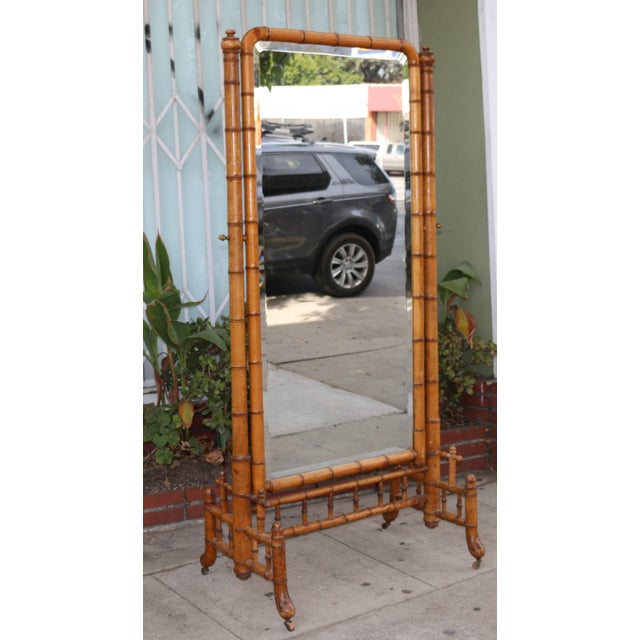 Vintage beautiful Bamboo Floor Mirror with wooden legs. Mirror is well kept, has minor dirt marks.. Bamboo frame is well...