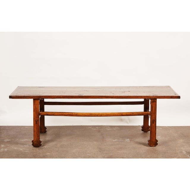 "A ""one of a kind"" kang table - otherwise known as either a low table or a chair-level bed- with solid elm wood table top..."