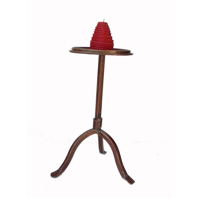 """A decorative table top metal bronze candle holder that was made in China. Dimensions: Dia 8"""" x h13"""""""