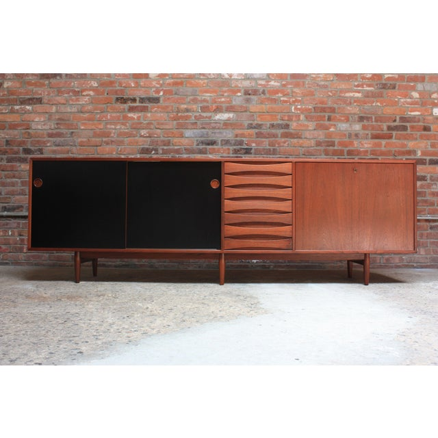This impressive teak sideboard was designed in the 1950s by Arne Vodder for Sibast Mobler (Model 29A). It features seven...
