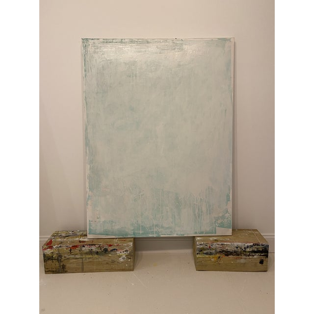 Light washes of acrylic paint in decreasing saturation of color are layered onto a minimally textured canvas base in a...