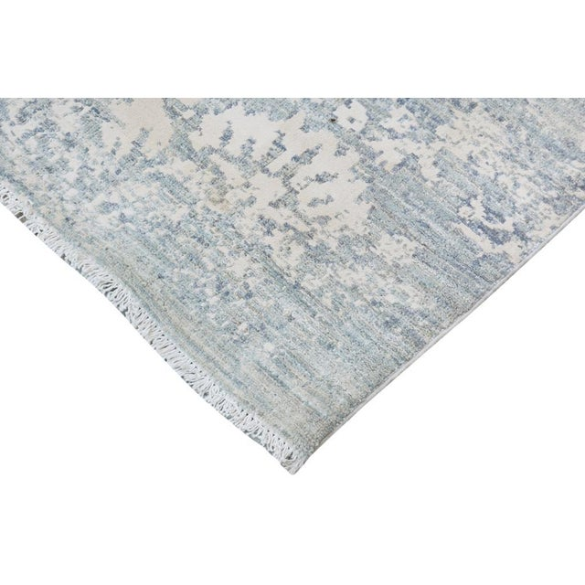 Fashionable modern handmade rug crafted by skilled artisans with trendy an elegant design with sophisticated modern...