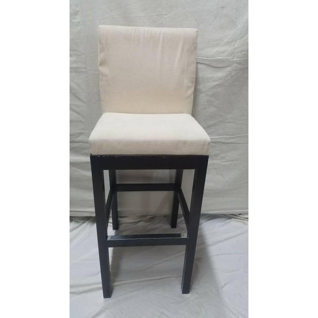 CJC Concepta Barcelona Bar Stool with Ivory Fabric and padded seat. Wenge Wood frame with stainless steel profile...