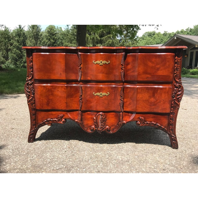 Very nice dresser by John Widdicomb out of Grand Rapids Michigan. Cherry wood with carved details and integrated wooden...
