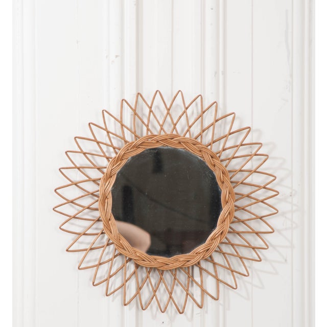 This fun vintage rattan sunburst mirror is from England, c. 1960's and would add a touch of the eclectic to any interior!