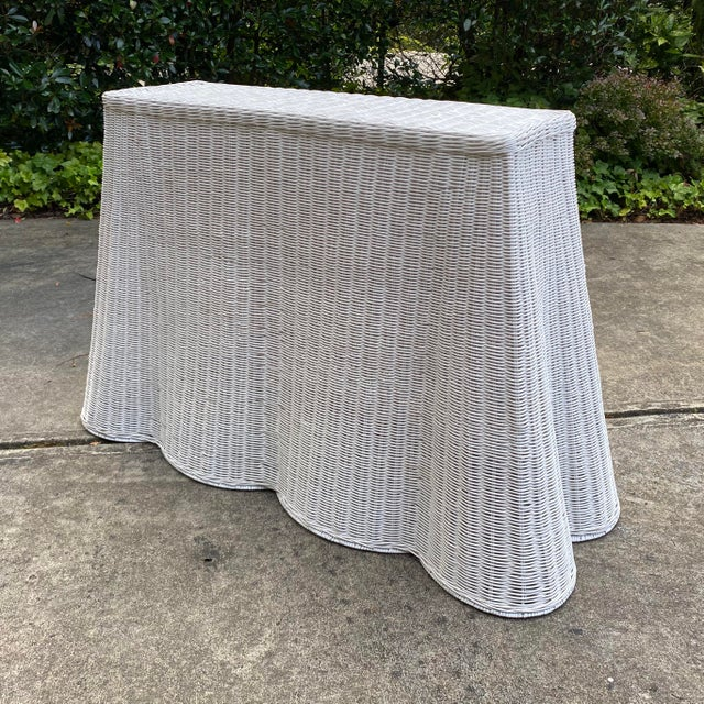 Hand woven natural rattan console table. Sturdy construction with metal frame inside. Indoor and covered outdoor safe. Top...