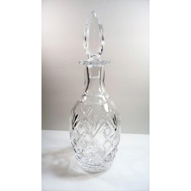 Vintage elegant lead crystal cut glass decanter with flame finial shape stopper. Etched on base Royal Doulton England....