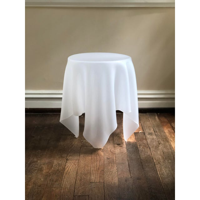 Ghost handkerchief style transparent side table of acrylic.