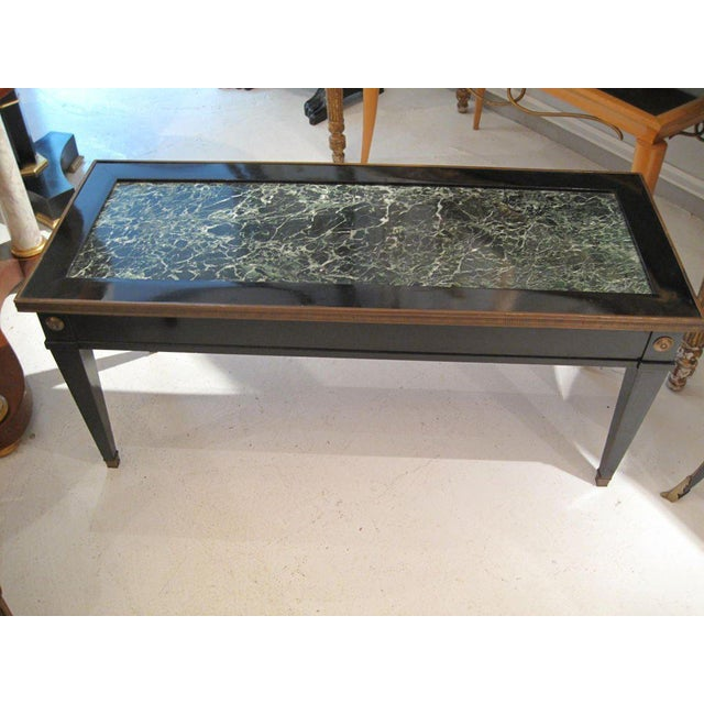 Jansen marble-top coffee table in the Directoire manner.